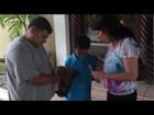 Alida Kemp Fonds prays for a young boy in the street of La Ceiba (part 2 of 2)