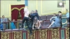 Topless feminist protest in Spain's parliament over...