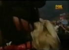 Rikishi stinkfaces Trish Stratus